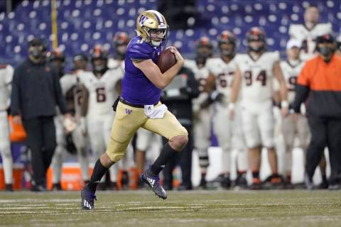 Washington quarterback Dylan Morris in action against Oregon State during an NCAA college footb ...