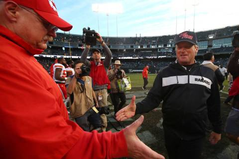Kansas City Chiefs head coach Andy Reid, left, shakes hands with Oakland Raiders head coach Jon ...