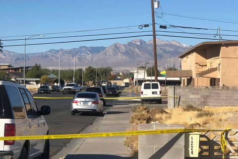 Police investigate a homicide in the area of Miller Avenue and Lexington Street on Saturday, No ...