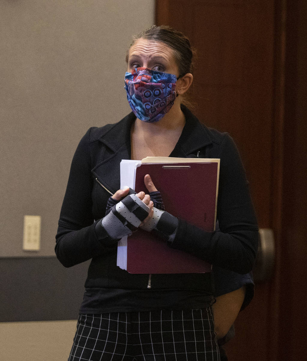 Attorney Sarah Hawkins shields her client, Amanda Sharp-Jefferson, charged with murder in conne ...