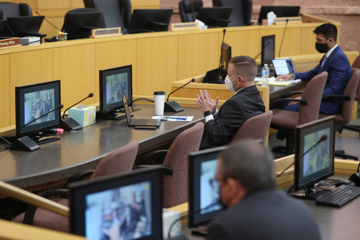 Chief Deputy District Attorney Michael Dickerson, center, watches police body camera footage sh ...