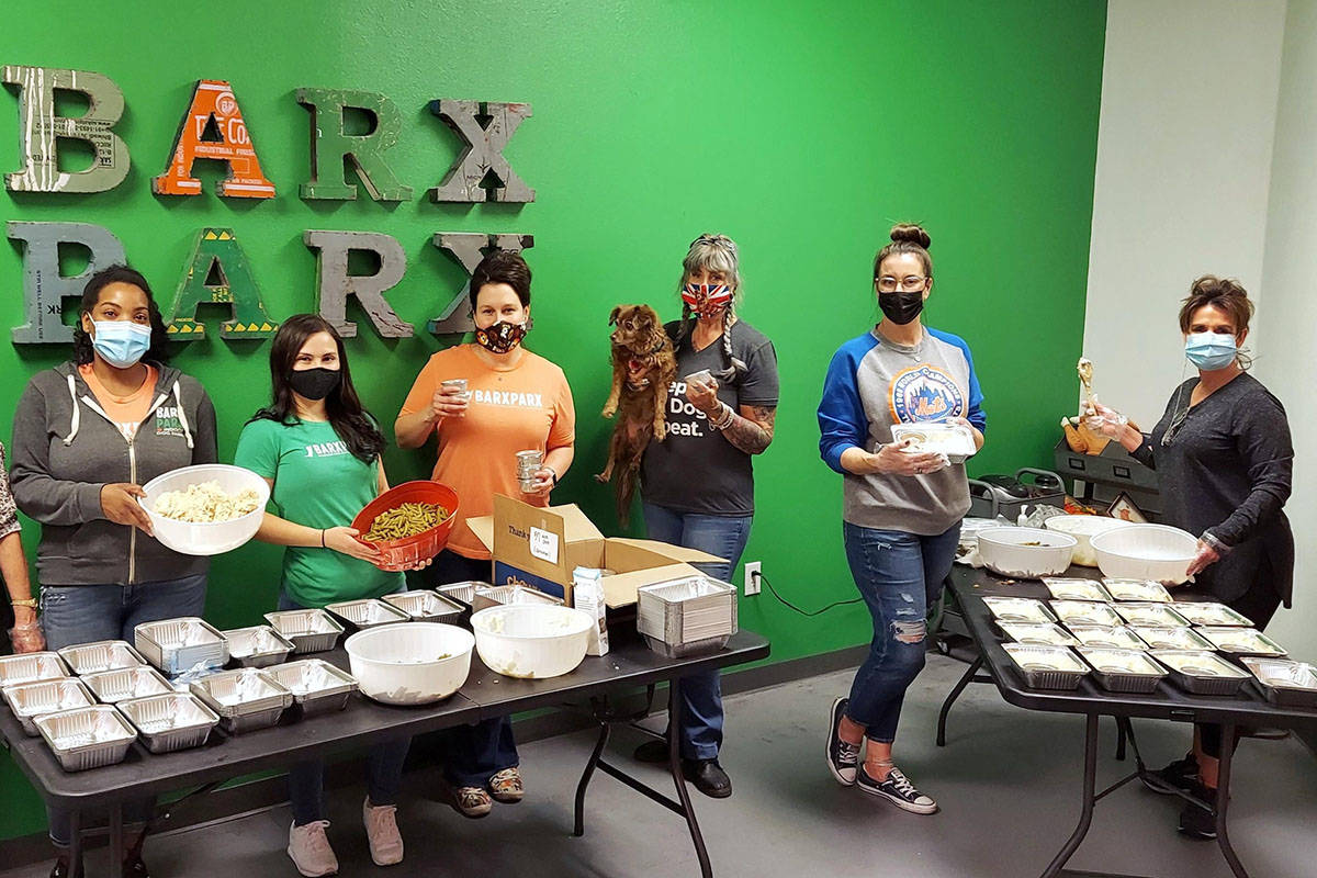 """An assembly line of volunteers on Sunday, Nov. 22, 2020, preps """"PUPsgiving"""" meals inside Barx P ..."""