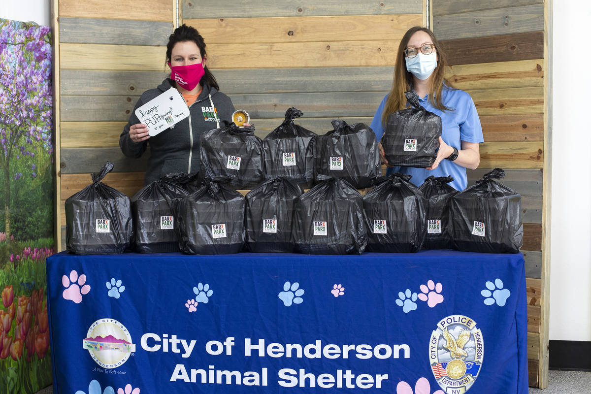 Jen Freet, owner of Barx Parx, left, and Kianna Dombrowski, kennel attendant at the Henderson A ...