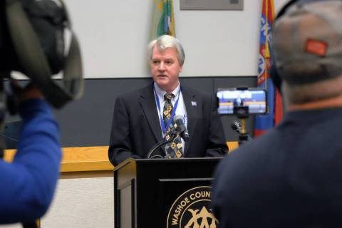 Kevin Dick, health officer for the Washoe County Health District, takes questions on the county ...