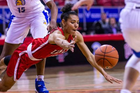 UNLV Lady Rebels guard Bailey Thomas (14, below) dives for a loose ball with San Jose State Spa ...