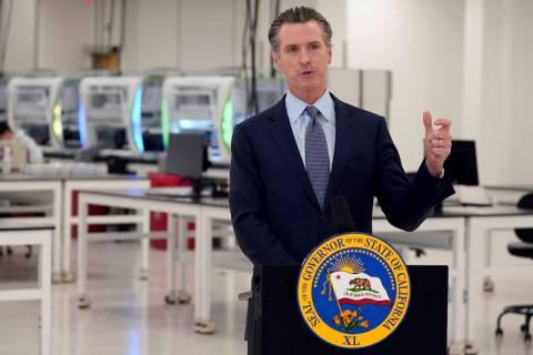 California Gov. Gavin Newsom speaks at a COVID-19 testing facility in Valencia, Calif., in Octo ...