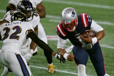 New England Patriots quarterback Cam Newton (1) carries the ball as Baltimore Ravens safety DeS ...
