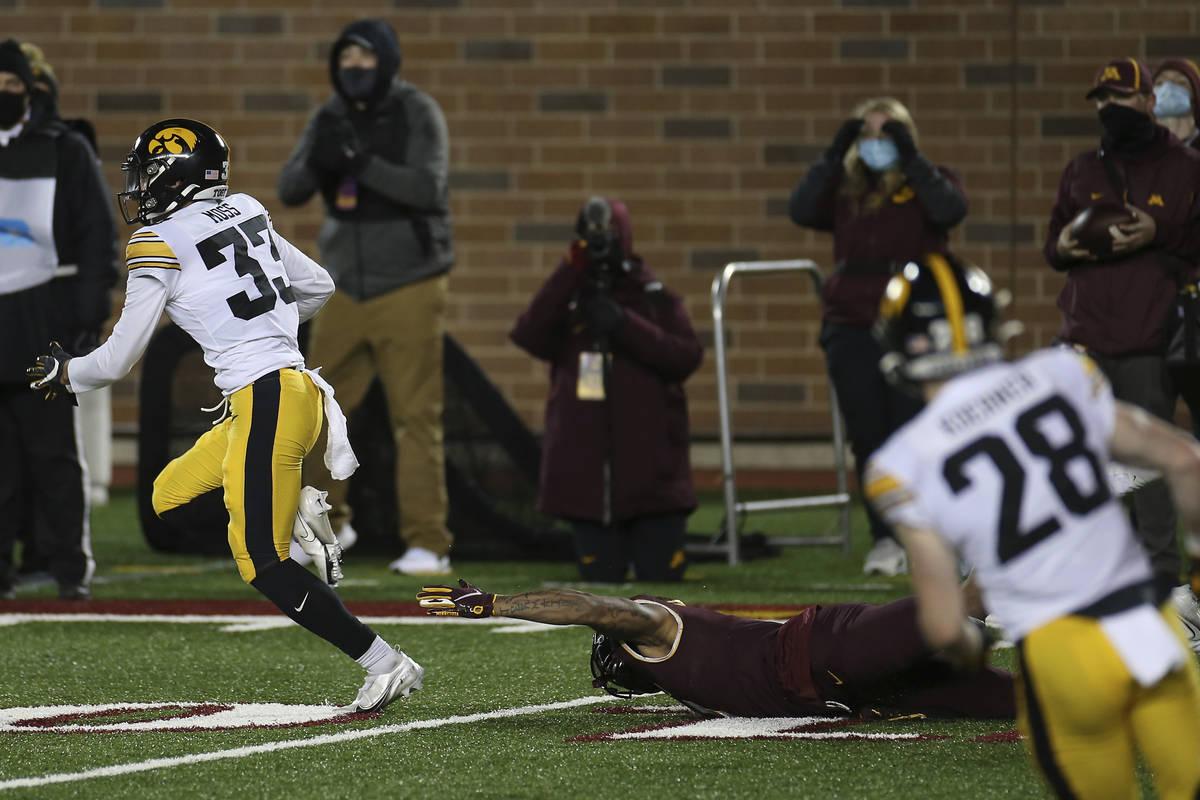 Iowa defensive back Riley Moss (33) outruns Minnesota wide receiver Chris Autman-Bell (7) after ...