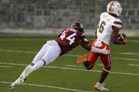 Mark Pope of Miami, right, runs towards the end zone for the game-winning score past Virginia T ...