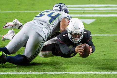 Arizona Cardinals quarterback Kyler Murray (1) dives in for a touchdown against Seattle Seahawk ...