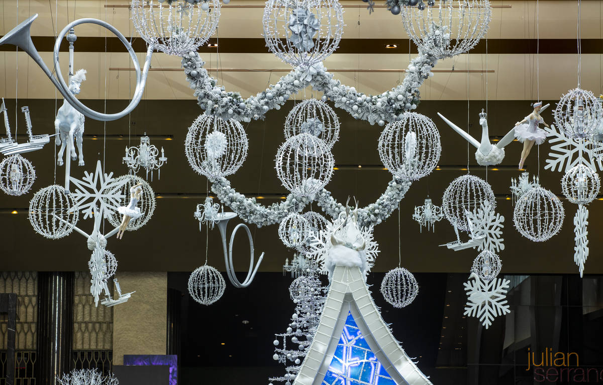 Lighting and decorations hang from the ceiling as part of the Aria's Sugar Palace lobby display ...