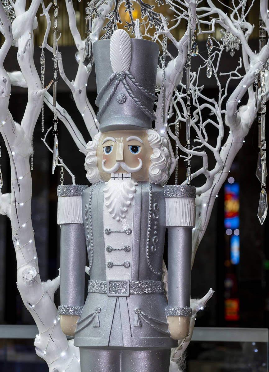 Nutcrackers are apart of the Aria holiday lobby display, which required 4,000 pounds of sugar t ...