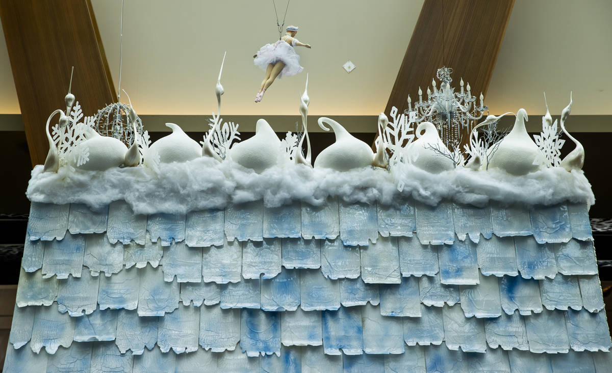 Seven various sugar techniques are employed including sugar swans atop the roof at Aria's holid ...