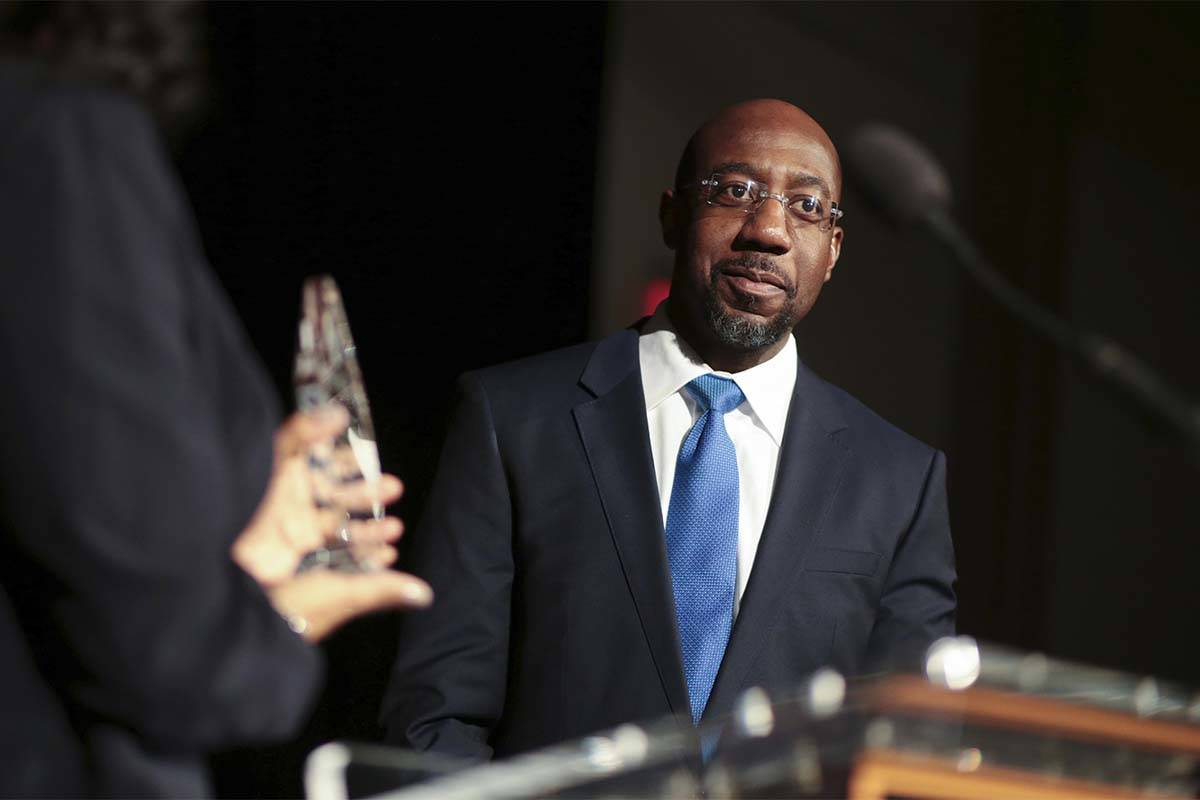 "Pastor Raphael Gamaliel Warnock, of Ebenezer Baptist Church, receives a ""President's Fulfilling ..."