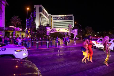 Las Vegas Strip visitors cross Las Vegas Boulevard outside The Mirage during Labor Day weekend ...