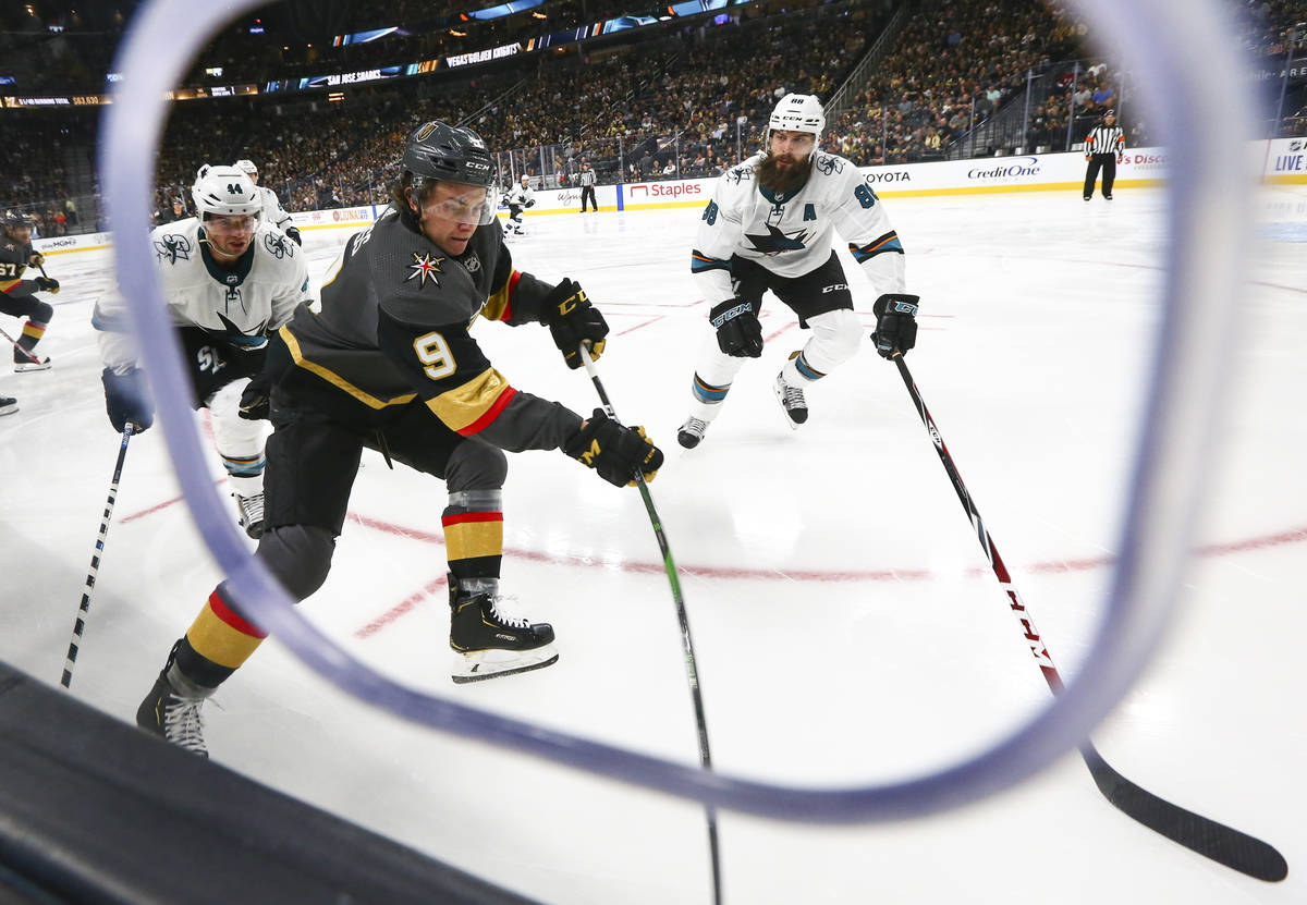 Golden Knights' Cody Glass (9) moves the puck against San Jose Sharks' Brent Burns (88) during ...