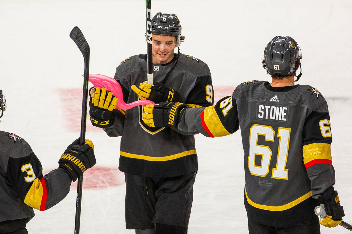 Vegas Golden Knights center Cody Glass (9) receives a pink flamingo from teammate right wing Ma ...