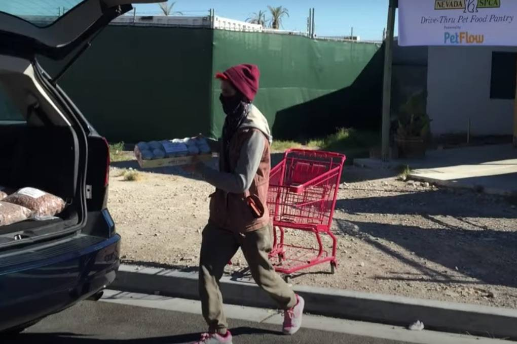 Pet food is provided to needy Nevadans during a Sunday drive-through event held by Nevada SPCA ...