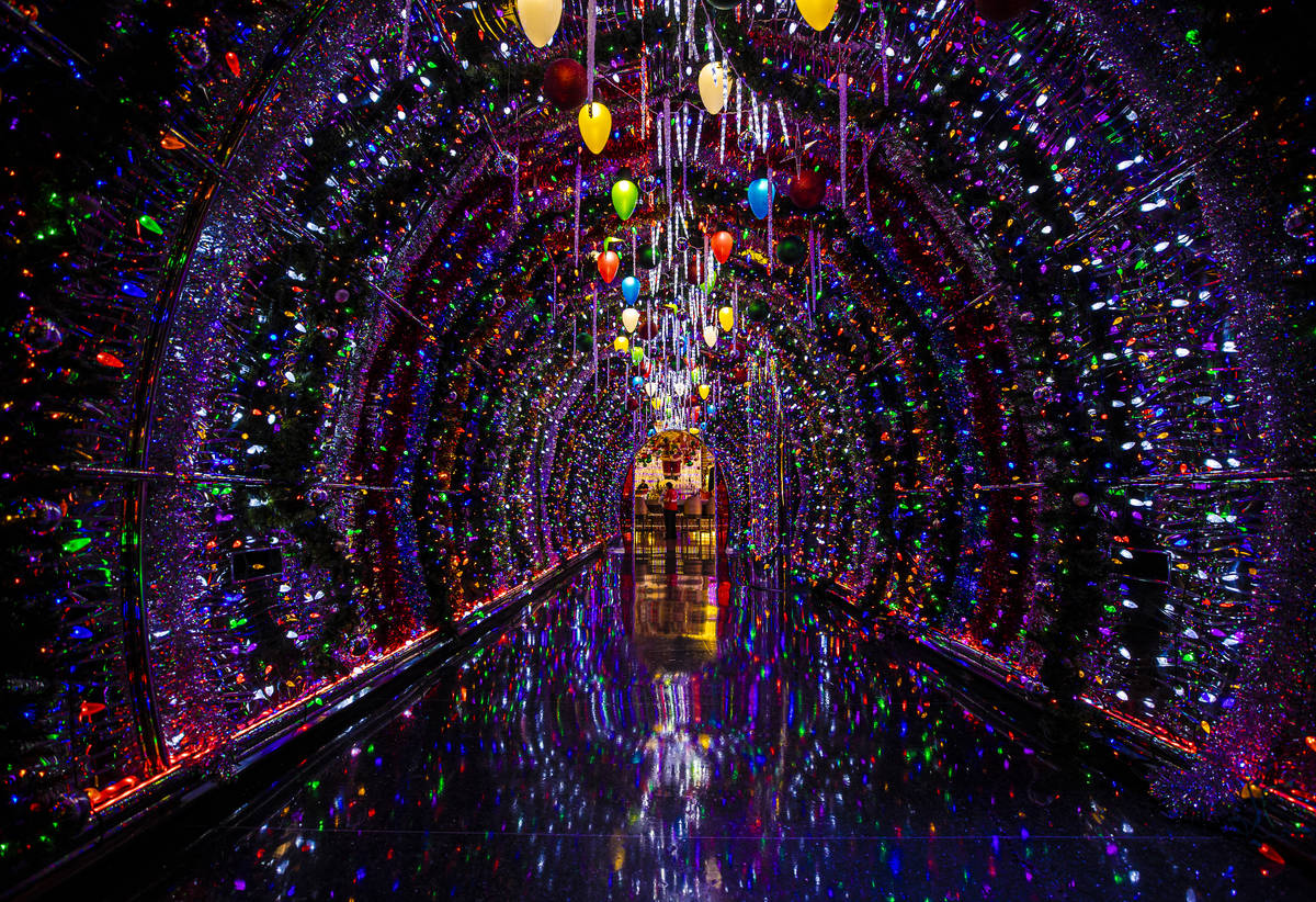 Thousands of bulbs light up the hallway leading to the main lounge at Red Rock Resort's Christm ...