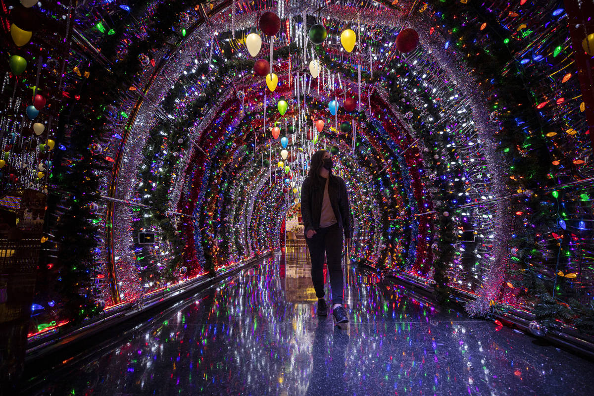 Katrina Albana walks through a hallway lit with thousands of bulbs leading to the main lounge a ...