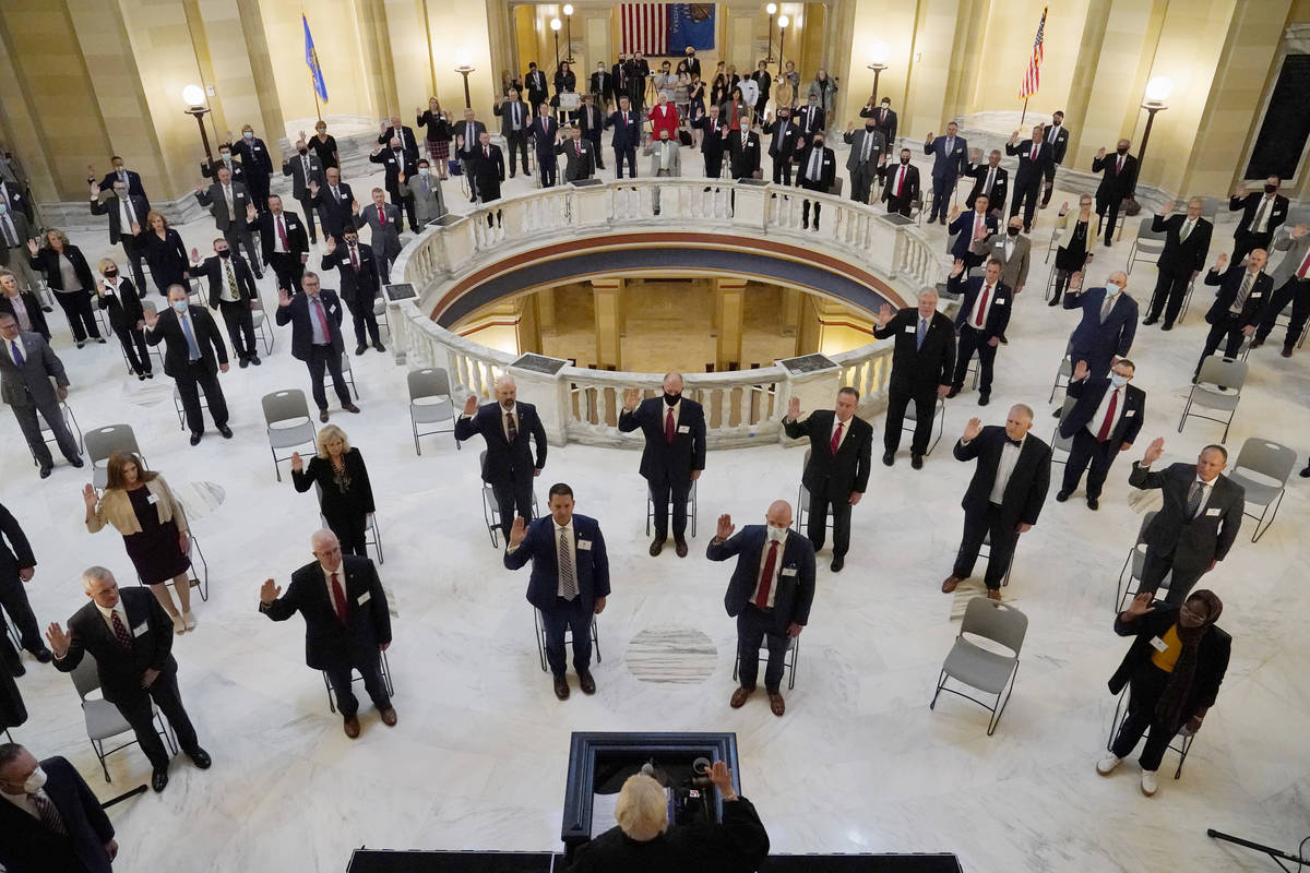FILE - In this Wednesday, Nov. 11, 2020 file photo, House members participate in a ceremonial s ...
