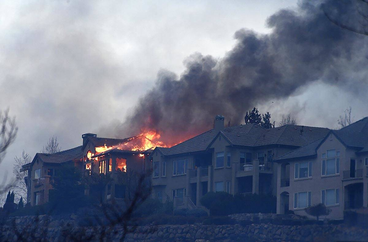 A large home burns during the Pinehaven Fire in the Caughlin Ranch area of Reno on Tuesday, Nov ...