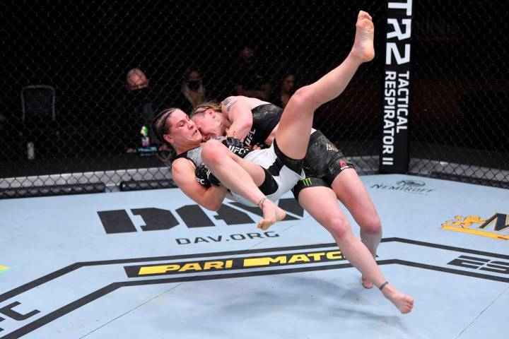 (R-L) Valentina Shevchenko of Kyrgyzstan takes down Jennifer Maia of Brazil in their women's f ...