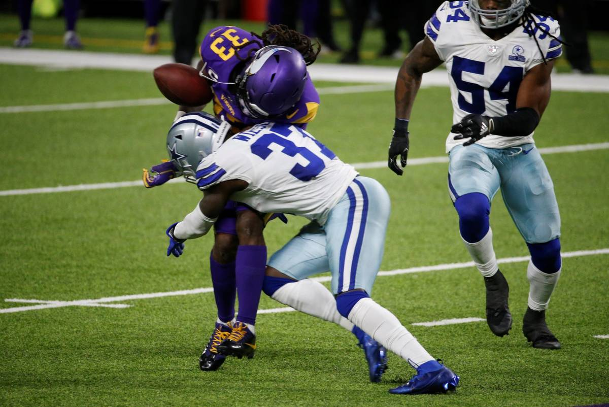 Minnesota Vikings running back Dalvin Cook (33) fumbles as he is hit by Dallas Cowboys safety D ...