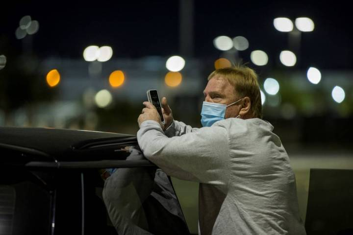 Raiders owner Mark Davis looks on as the team prepares to honor the Las Vegas shooting victims ...