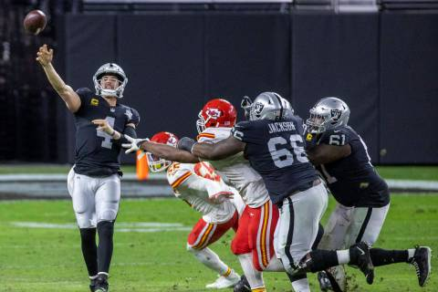 Las Vegas Raiders quarterback Derek Carr (4) gets off a pass under pressure by the Kansas City ...