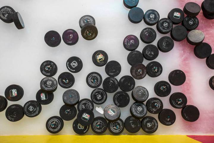 Golden Knights practice pucks lay on the ice before the start of morning skate ahead of game on ...