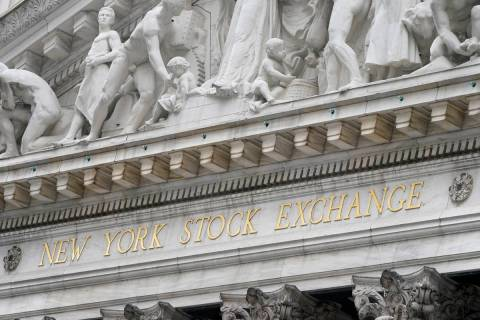 The sign is displayed at the New York Stock Exchange in New York, Monday, Nov. 23, 2020. Stock ...