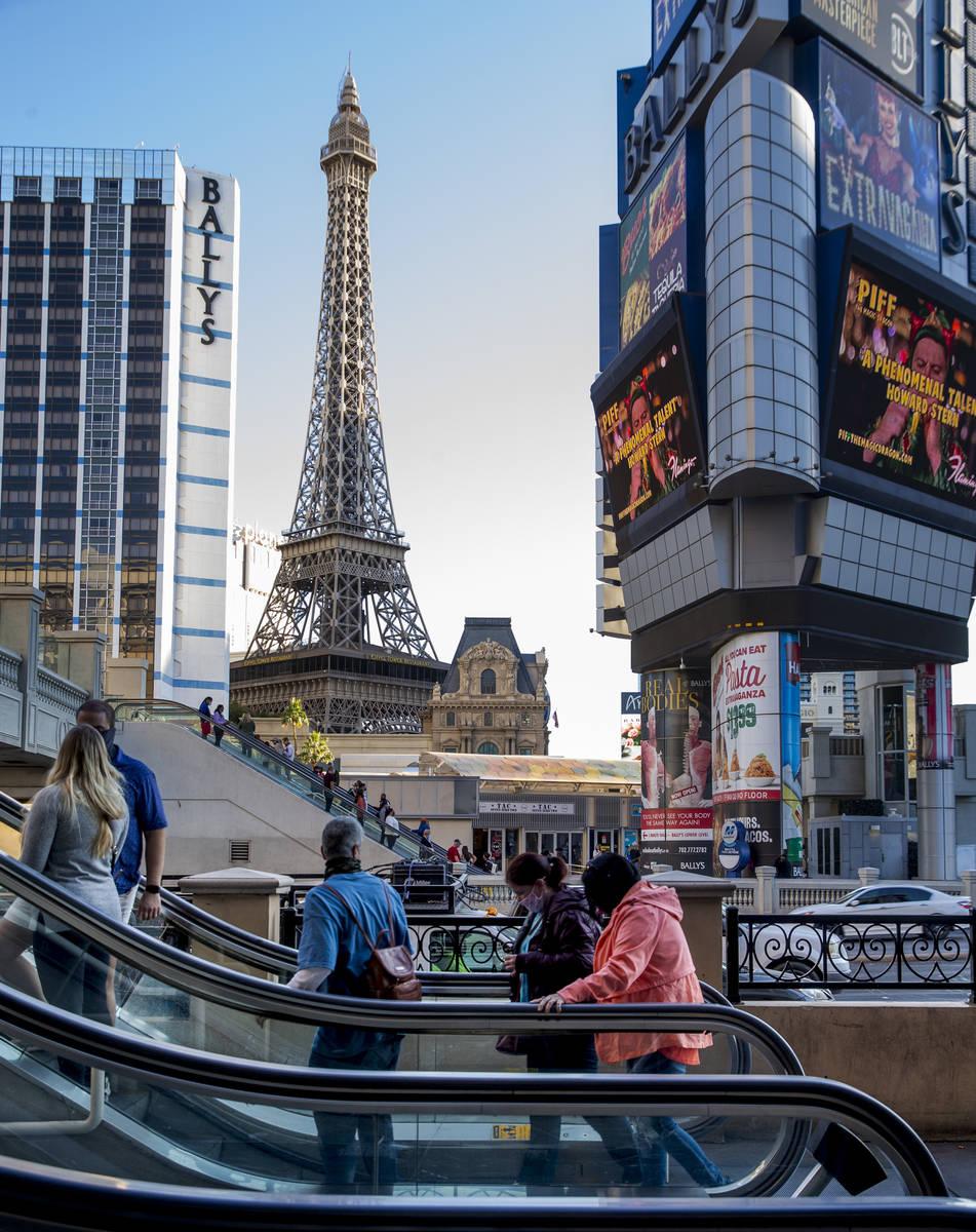 Pedestrians take the escalators adjacent to The Cromwell and BallyÕs along the Las Vegas S ...