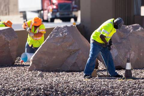 Workers from the Nevada Department of Transportation (NDOT) replace copper wire after Spaghetti ...