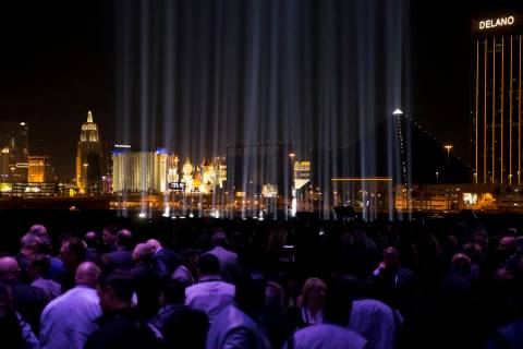 A light for each person who died in the mass shooting illuminates the sky during the Raiders St ...