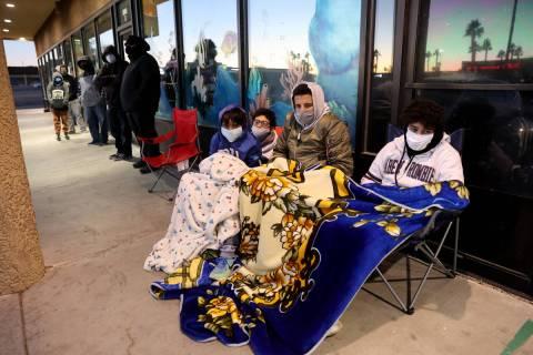 Anwar Ouaddi, 12, from left, Iliass Khould, 16, Mo Khould, 17, and Adam Ouaddi, 16, stay warm w ...