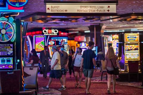 Guests wander about a main walkway in the casino as the Mirage reopens following a COVID-19 shu ...