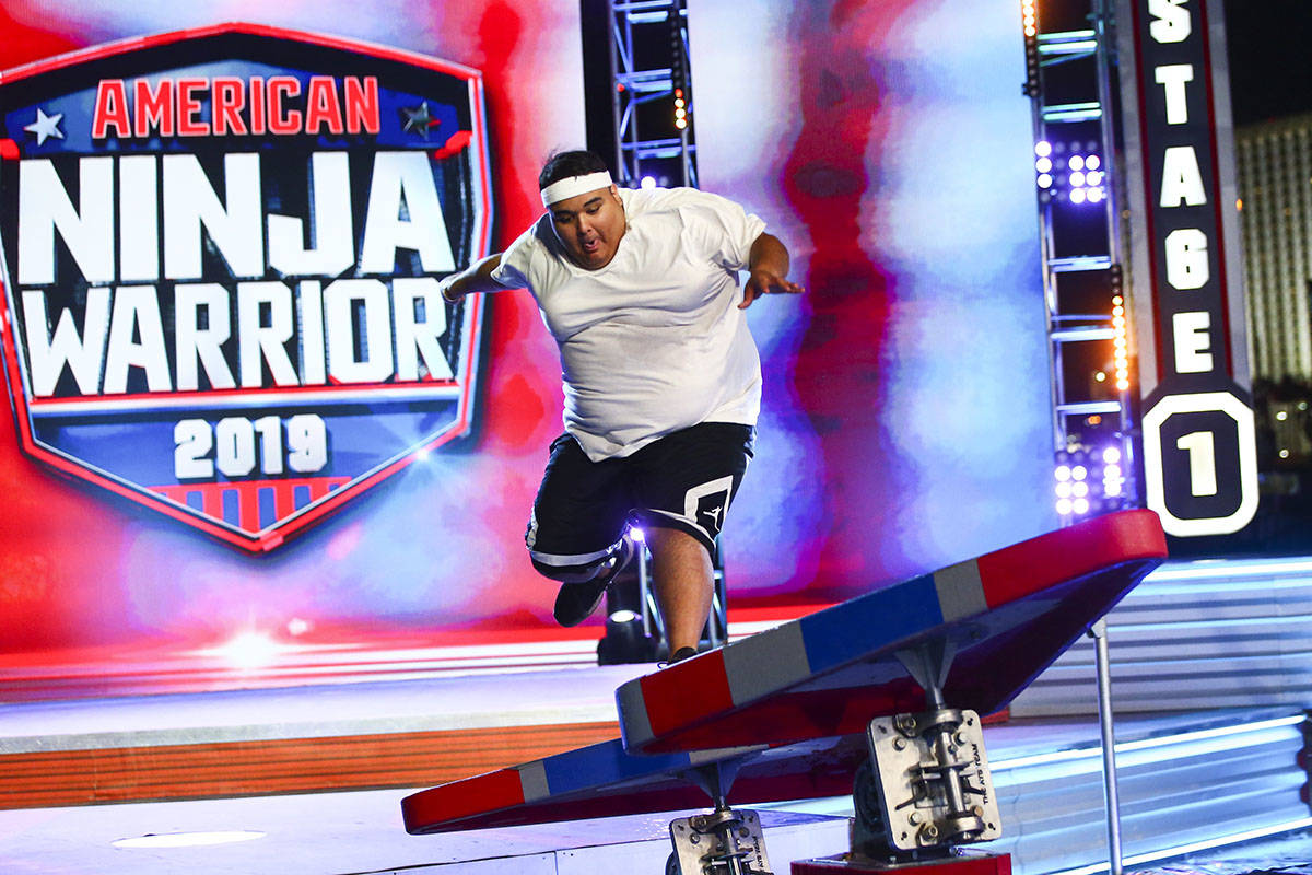 Adrian Hernandez, of Hot 97.5, attempts the first obstacle from stage one during demonstrations ...