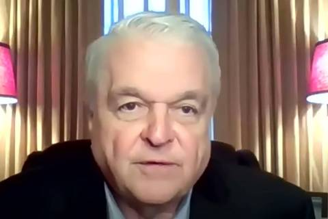 Gov. Steve Sisolak appears remotely during a press conference Nov. 22, 2020, announcing new res ...