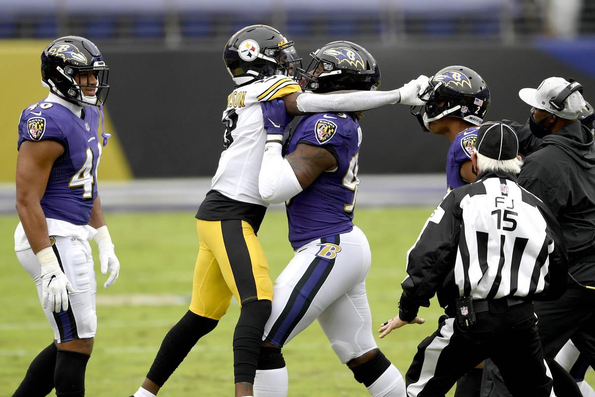 Baltimore Ravens outside linebacker Matt Judon, center, pushes Pittsburgh Steelers wide receive ...