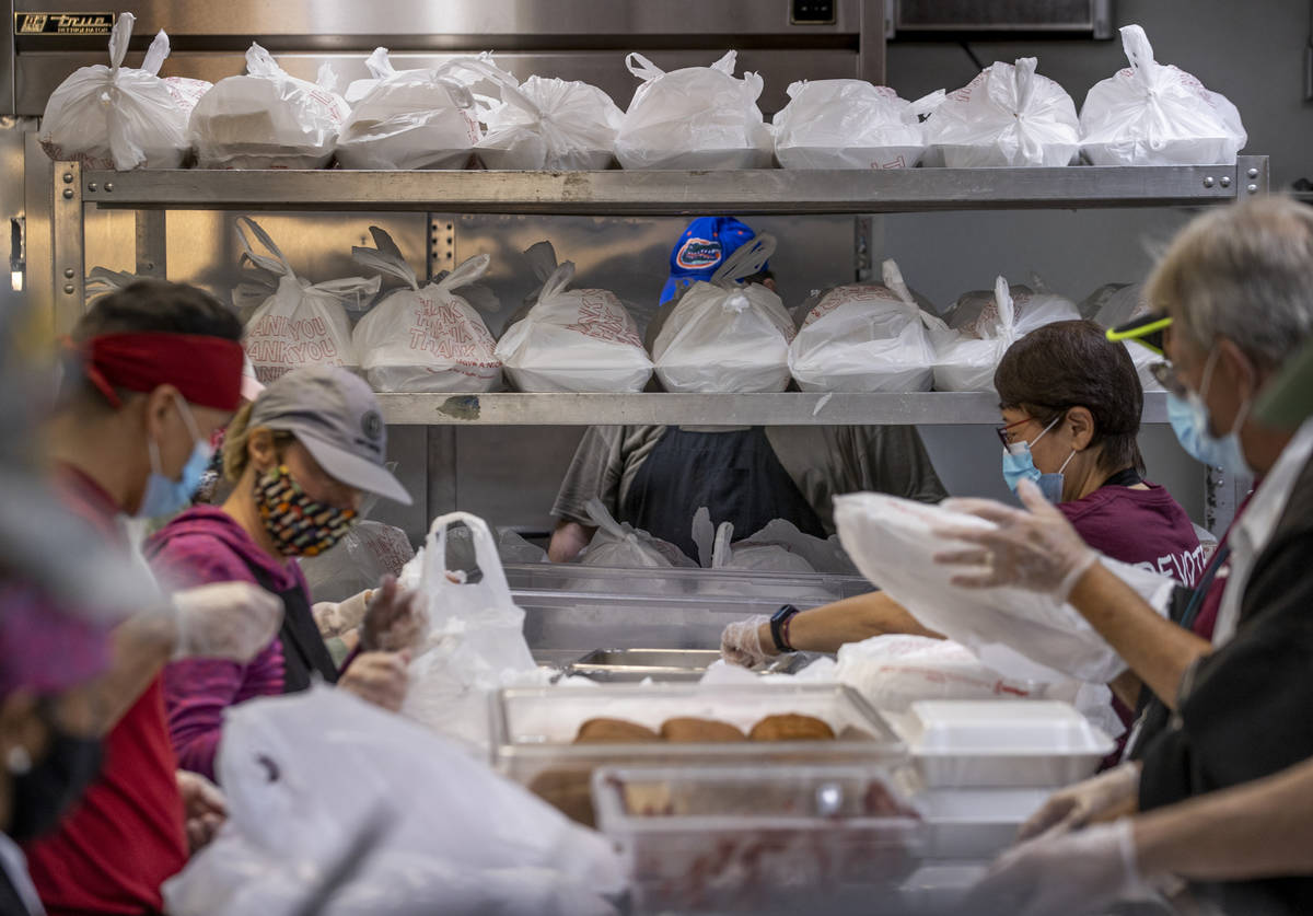 Volunteers prep several hundred Thanksgiving meals at the Las Vegas Rescue Mission with food do ...