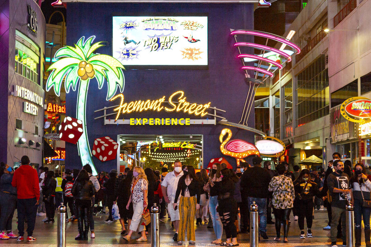 People walk along the Fremont Street Experience in downtown Las Vegas on Saturday, Nov. 21, 202 ...
