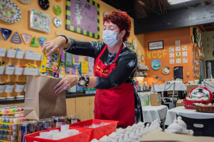 Co-founder of All Fired Up Gail Schomisch packs a holiday pottery to-go kit in the pottery stud ...