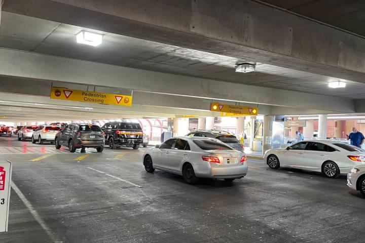 Vehicles line up to awaiting travelers at McCarran International Airport's passenger pick up ar ...