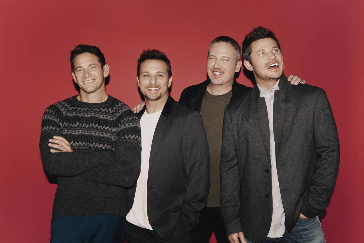 Member of 98 Degrees are shown, from left: Jeff Timmons, Drew Lachey, Justin Jeffre and Nick La ...