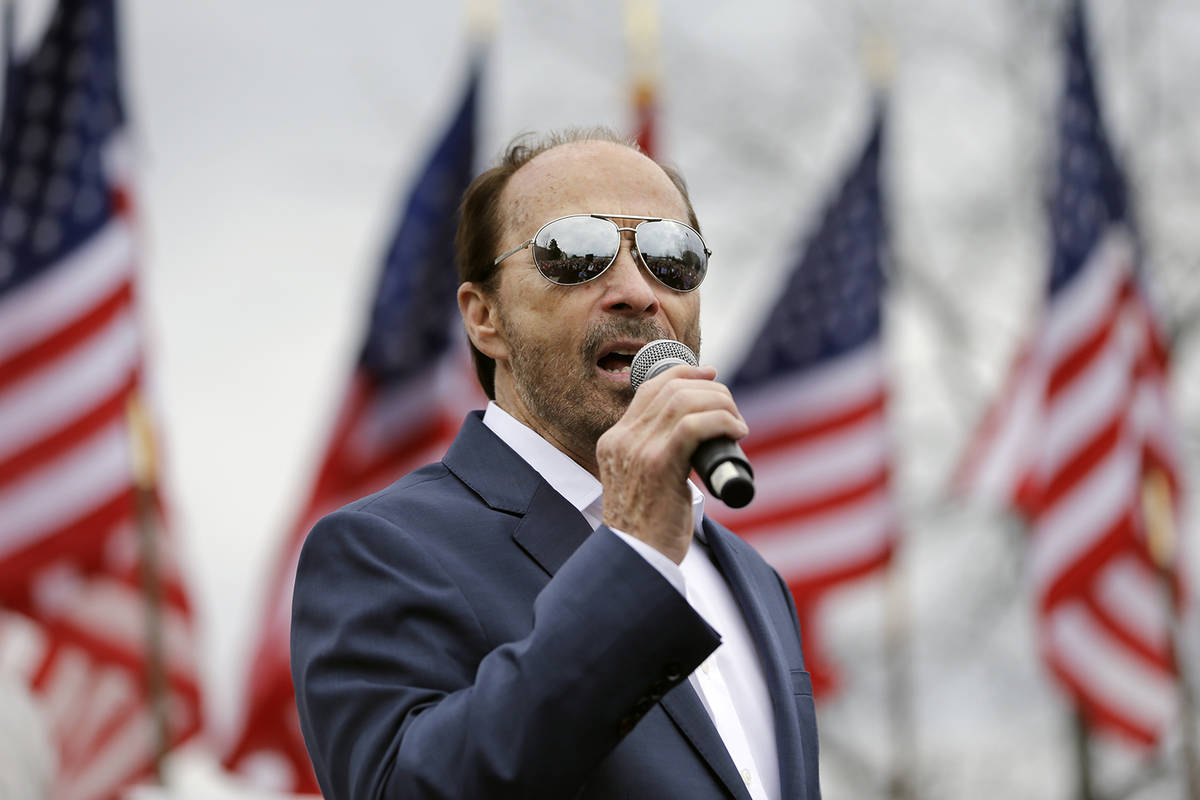 Country music singer Lee Greenwood performs at a rally for Republican presidential candidate Se ...