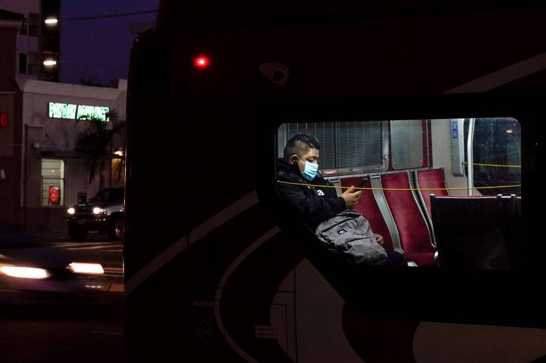 A person wears a mask to prevent the spread of coronavirus on a city bus Tuesday, Nov. 24, 2020 ...