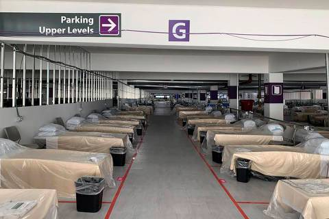 Hospital beds sit inside Renown Regional Medical Center's parking garage, which has been transf ...