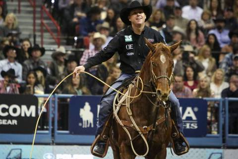 Trevor Brazile of Decatur, Texas (2) competes in tie-down roping during the tenth go-round of t ...