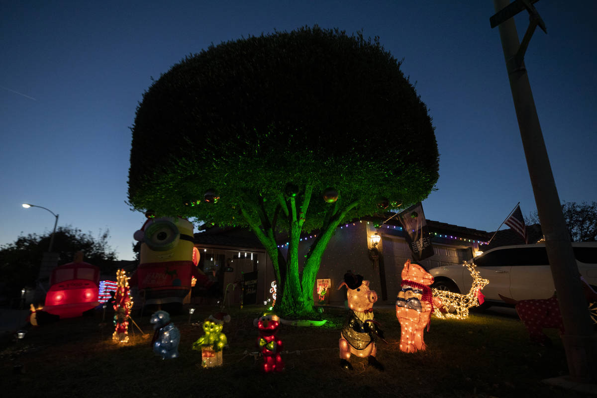 A house in the Green Valley South neighborhood off Pecos Road in Henderson is decorated for the ...